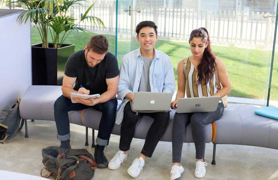 Three students sitting on a couch