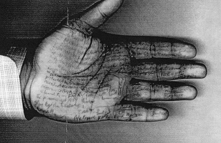 A hand with notes written on it used to cheat in an exam