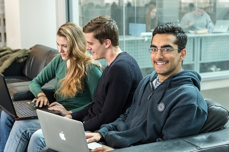 Three students with laptops
