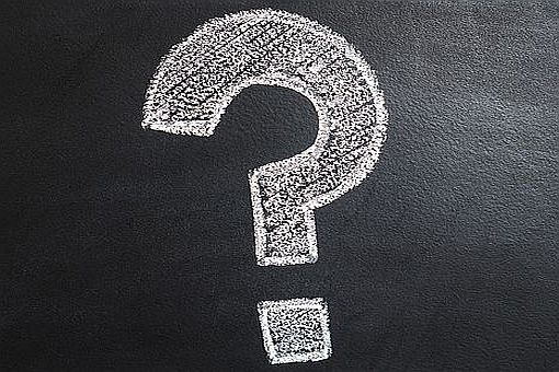 a big chalk question mark on a blackboard - link to evaluation questions page