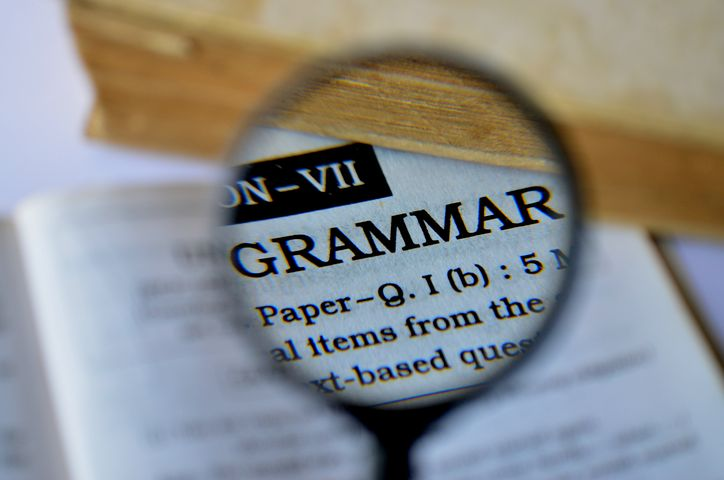 magnifying glass over a dictionary entry saying grammar