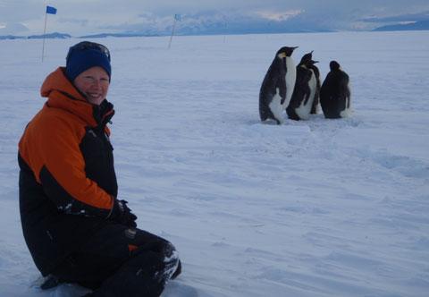 Waikato University student Tanya O'Neill with some Emperor penguins at Scott Base.
