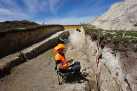 Earth Sciences student Joshua Hughes hard at work in the Morrinsville trench.