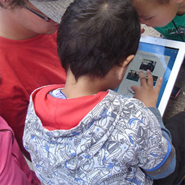 Young children using iPads