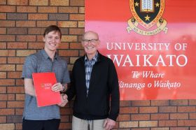 Tauranga student Ben Grindrod is presented with the inaugural University of Waikato Squash Scholarship by Dudley Bell.