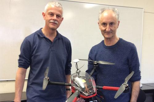 Michael Cree and John Perrone, preparing a drone