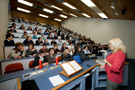 A Lecturer doing their thing in a typical lecture theatre
