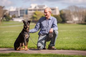 Dr Tim Edwards and his dog Tui.