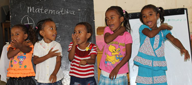 Children performing actions to the watermelon song at Raime homebased ECD service in Liquica.